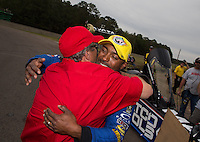 Mar. 17, 2013; Gainesville, FL, USA; NHRA team owner Don Schumacher (left) celebrates with top fuel dragster driver Antron Brown after winning the Gatornationals at Auto-Plus Raceway at Gainesville. Mandatory Credit: Mark J. Rebilas-