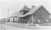 Trackside view of frame railroad depot.<br /> D&amp;RG  Florence, CO