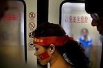 Chinese Olympic team fans on a subway in Beijing, China on Sunday, August 10, 2008.  Kevin German