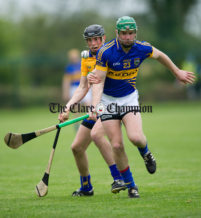 Mark Earley of Clare in action against Noel Mc Grath of Tipperary during their game as part of the official opening of Clonlara GAA field. Photograph by John Kelly.