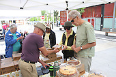 The Harper Court Farmer&rsquo;s Market opened this past Thursday after a nine year hiatus.<br /> <br /> 3631 &ndash; Norlene Wolfe and David Taylor purchase pies from Robert Eustace of Marilyn&rsquo;s Bakery.<br /> <br /> All rights to this photo are owned by Spencer Bibbs of Spencer Bibbs Photography and may only be used in any way shape or form, whole or in part with written permission by the owner of the photo, Spencer Bibbs.<br /> <br /> For all of your photography needs, please contact Spencer Bibbs at 773-895-4744. I can also be reached in the following ways:<br /> <br /> Website &ndash; www.spbdigitalconcepts.photoshelter.com<br /> <br /> Text - Text &ldquo;Spencer Bibbs&rdquo; to 72727<br /> <br /> Email &ndash; spencerbibbsphotography@yahoo.com
