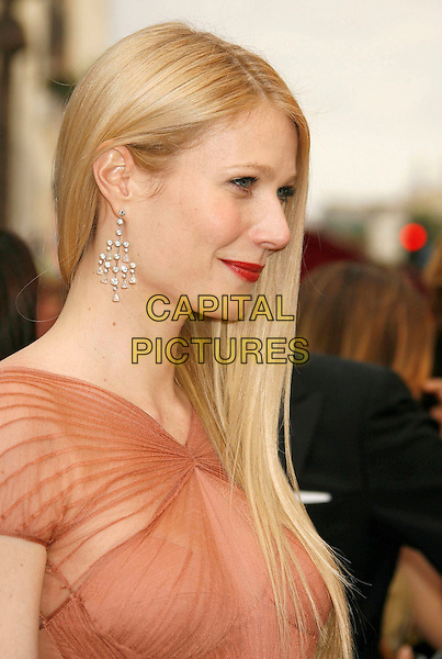GWYNETH PALTROW.The 79th Annual Academy Awards - Arrivals held at the Kodak Theatre, Hollywood, California, USA,.February 25th, 2007..oscars red carpet portrait headshot orange peach Zac Posen pleated dress gown red lipstick profile.CAP/ADM/RE.©Russ Elliot/AdMedia/Capital Pictures...