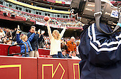 Landover, MD - December 22, 2002 -- Washington Redskin Fan Stella Harrison celebrates her catching an impromptu souvenir game ball from an errant field goal attempt in the December 22, 2002 game against the Houston Texans at FedEx Field in Landover, Maryland..Credit: Ron Sachs / CNP