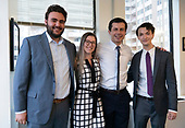 Mayor Pete Buttigieg takes a photo with Harry Applestein, Rebekah Macarthur, and Matt Landini at a communal parlor meeting at the offices of Bluelight Strategies in Washington D.C., U.S. on May 23, 2019.<br /> <br /> Credit: Stefani Reynolds / CNP