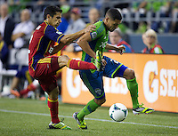 Tony Beltran, left, of Real Salt Lake battles Lamar Neagle of the Seattle Sounders FC for the ball during play at CenturyLink Field in Seattle Friday September 13, 2013. The Sounders won the match 2-0.