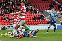 Matthew Bloomfield of Wycombe Wanderers lays on the floor as he watches his effort hit the back of the net to score the opening goal during the Sky Bet League 2 match between Doncaster Rovers and Wycombe Wanderers at the Keepmoat Stadium, Doncaster, England on 29 October 2016. Photo by David Horn.
