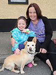 Linda and Lily Malone pictured with Sparky at the Ardee Beat on the Street. Photo: Colin Bell/pressphotos.ie