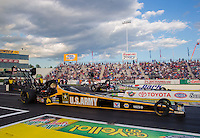 May 30, 2014; Englishtown, NJ, USA; NHRA top fuel driver Tony Schumacher (near lane) races alongside Brittany Force during qualifying for the Summernationals at Raceway Park. Mandatory Credit: Mark J. Rebilas-