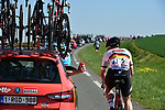 Andre Greipel (GER) Lotto-Soudal talks to his team car during the 115th edition of the Paris-Roubaix 2017 race running 257km Compiegne to Roubaix, France. 9th April 2017.<br /> Picture: ASO/P.Ballet | Cyclefile<br /> <br /> <br /> All photos usage must carry mandatory copyright credit (&copy; Cyclefile | ASO/P.Ballet)