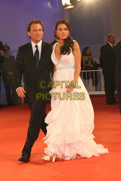 "CHRISTIAN SLATER & LINDSAY LOHAN.""Bobby"" Premiere during The 63rd International Venice Film Festival held at Palazzo del Cinema, Lido, Italy..September 5th, 2006.Ref: ADM/ZL.full length white dress gown silver diamante straps black suit.www.capitalpictures.com.sales@capitalpictures.com.©Zach Lipp/AdMedia/Capital Pictures."