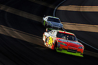 Mar. 1, 2009; Las Vegas, NV, USA; NASCAR Sprint Cup Series driver Jeff Gordon (24) leads teammate Jimmie Johnson (48) during the Shelby 427 at Las Vegas Motor Speedway. Mandatory Credit: Mark J. Rebilas-