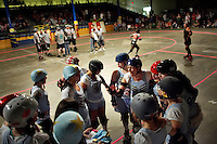 Sarah Doom leads her team in a timeout huddle during a roller derby bout in Wilmington, Massachusetts. Roller derby is an American contact sport, popular with young women, which combines both athleticism and a satirical punk third-wave feminism aesthetic.