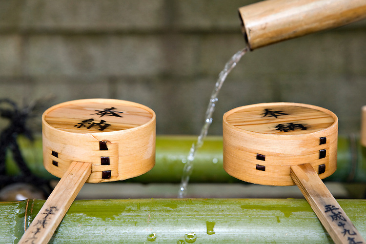 Wooden ladles for temizu at a bamboo water reservoir in Kyoto Japan