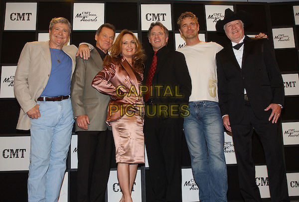 BEN JONES, SUNNY SHROYER, CATHERINE BACH & JAMES BEST - DUKES OF HAZZARD.2005 CMT Music Awards Pressroom held at the Gaylord Entertainment Center, Nashville, Tennessee. .April 11th, 2005.Photo: George ShepherdAdMedia/Capital Pictures.Ref: GS/ADM.half length cowboy hat stetson black grey beige jacket brown metallic dress.www.capitalpictures.com.sales@capitalpictures.com.© Capital Pictures.