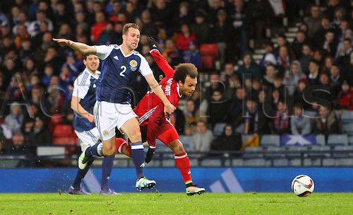 29.03.2016. Hampden Park, Glasgow, Scotland. International Football Friendly Scotland versus Denmark.  Steven Whittaker holds off the challenge of Martin Braithwaite