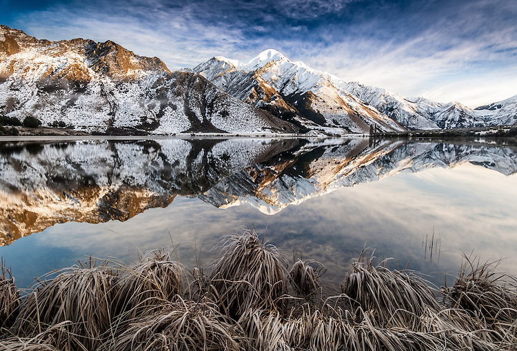 Frosty morning, still reflection of snowy hills at Moke Lake near Queenstown, Central Otago, South Island, New Zealand