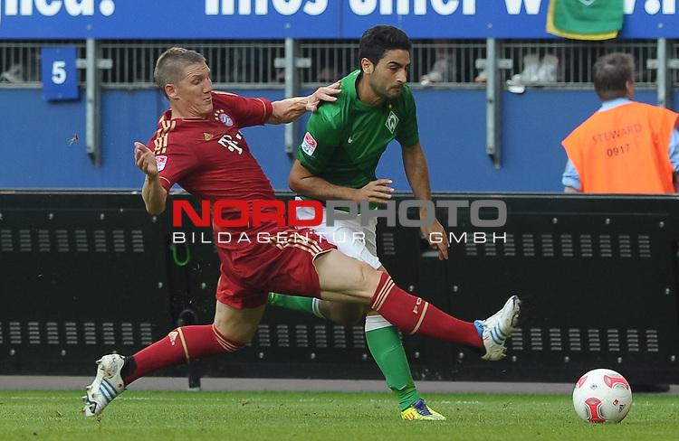 04.08.2012, Imtech Arena, Hamburg, GER, LIGA total! Cup 2012, FC Bayern M&uuml;nchen / Muenchen vs Werder Bremen, im Bild Bastian Schweinsteiger (Muenchen #31), Mehmet Ekici (Bremen #10)<br /> <br /> // during the match FC Bayern Muenchen vs Werder Bremen on 2012/08/04, Imtech Arena, Hamburg, Germany.<br /> Foto &copy; nph / Frisch *** Local Caption ***
