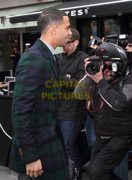 Marvin Humes arrives for his 1st Day at work at Capital FM, Leicester Square, London, England..28th March 2013.jls HALF length green blue check plaid tartan jacket coat camera photographer press paparazzi helmet side profile .CAP/ROS.©Steve Ross/Capital Pictures..