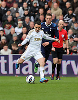 Pictured L-R: Leon Britton of Swansea against Gylfi Sigurdsson of Tottenham. Saturday 30 March 2013<br /> Re: Barclay's Premier League, Swansea City FC v Tottenham Hotspur at the Liberty Stadium, south Wales.