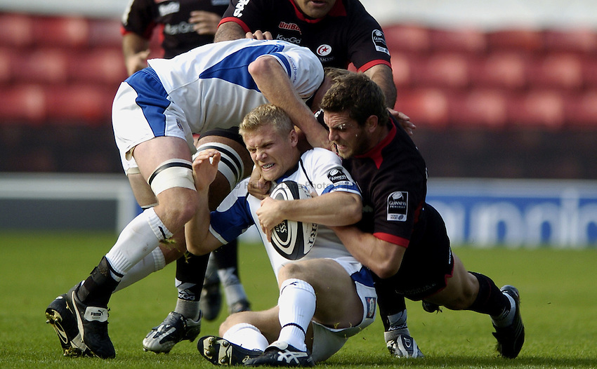 Photo: Jonathan Butler..Saracens v Bath Rugby. Guinness Premiership. 15/10/2006..Michael Stephenson of Bath is pushes backwards by Ben Johnston of Saracens.