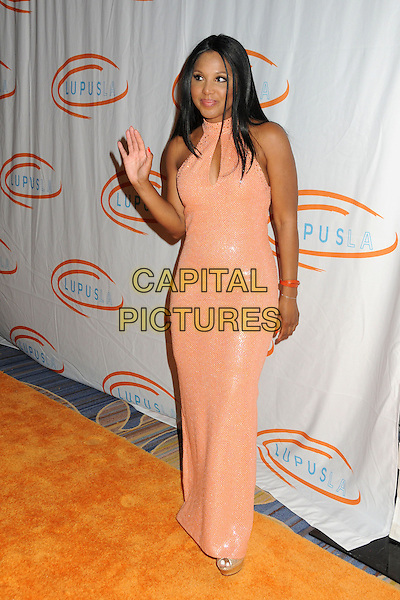 Toni Braxton.12th Annual Lupus LA Orange Ball held at the Beverly Wilshire Hotel, Beverly Hills, California, USA..May 24th, 2012.full length dress pink peach sleeveless hand waving  .CAP/ADM/BP.©Byron Purvis/AdMedia/Capital Pictures.