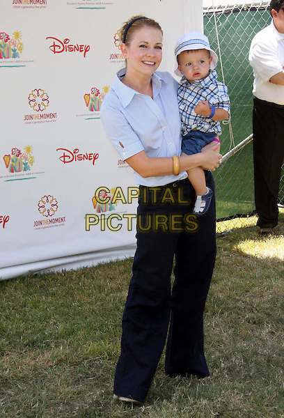 """MELISSA JOAN HART & son """"Brady"""" Braydon Hart Wilkerson .Elizabeth Glaser Pediatric AIDS Foundation 20th Annual A Time For Heroes Celebrity Carnival held at Wadsworth Theater, Los Angeles, CA, USA, 6th June, 2009..full length blue shirt baby hat hairband hair band bracelet  child kid carrying holding wide leg trousers navy .CAP/ADM/KB.©Kevan Brooks/Admedia/Capital Pictures"""