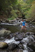 Crossing Iao Valley Stream, Maui, Hawaii.