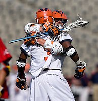 Steele Stanwick (6) of Virginia celebrates a goal with teammate Rhamel Bratton (3) during the ACC men's lacrosse tournament finals in College Park, MD.  Virginia defeated Maryland, 10-6.