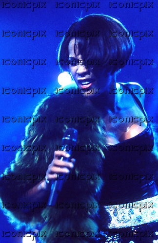 Whitney Houston (Aug 9, 1963 - Feb 11, 2012) - performing live on the My Love Is Your Love UK Tour at Wembley Arena in London UK - 16 Sep 1999.  Photo credit: George Chin/IconicPix