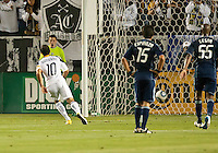 CARSON, CA – May 14, 2011: LA Galaxy midfielder Landon Donovan (10) watches his penalty kick go into the net during the match between LA Galaxy and Sporting Kansas City at the Home Depot Center in Carson, California. Final score LA Galaxy 4, Sporting Kansas City 1.