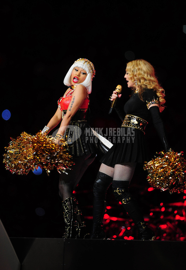Feb 5, 2012; Indianapolis, IN, USA; Madonna (right) performs with Nicki Minaj (left) during the halftime show for Super Bowl XLVI between the New York Giants and New England Patriots at Lucas Oil Stadium.  Mandatory Credit: Mark J. Rebilas-