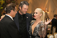 US entertainer Gwen Stefani (R), US entertainer Blake Shelton (C) and New York Governor Andrew Cuomo (L) attend a state dinner for Italian Prime Minister Matteo Renzi, hosted by US President Barack Obama, on the South Lawn of the White House in Washington DC, USA, 18 October 2016. President Obama hosts his final state dinner, featuring celebrity chef Mario Batali and singer Gwen Stefani performing after dinner. <br /> Credit: Michael Reynolds / Pool via CNP / MediaPunch