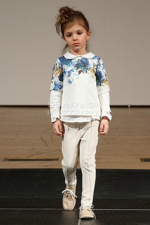 Model walks runway in an outfit by Patachou, during the petitePARADE Children's Club fashion show at the Jacob Javits Center in New York City, on January 9, 2016.