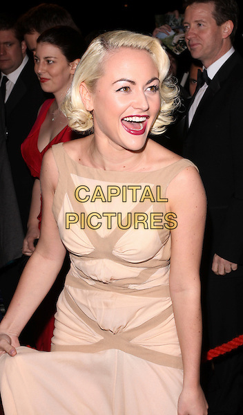 JAMIE WINSTONE.The British Academy Film Awards 2010 After Party at the Grosvenor Hotel, London, England..February 21st, 2010.BAFTA BAFTAs half length beige sleeveless dress brown peach mouth open smiling laughing red lipstick .CAP/AH.©Adam Houghton/Capital Pictures.