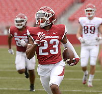 NWA Democrat-Gazette/ANDY SHUPE<br /> Arkansas cornerback Devin Bush returns an interception for a touchdown Saturday, April 6, 2019, during the Razorbacks' spring game in Razorback Stadium in Fayetteville. Visit nwadg.com/photos to see more photographs from the game.