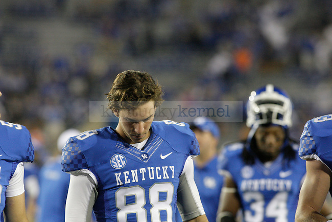 Kentucky Wildcats kicker Joe Mansour (88) walks off the field with his head down after the second half of the UK Football game against Florida at Commonwealth Stadium in Lexington, Ky., on Saturday, September, 28, 2013. Photo by Jonathan Krueger | Staff