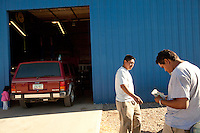 leaving0627 Ruben Rosario, 33, and Daniel Diaz, 22 (CQ) right, discuss how they are going to pay for a new water pump in Diaz's Jeep. The jeep broke down in Utah while they were driving across country to start a new live in Pennsylvania. Both are illegal immigrants.  (Pat Shannahan/ The Arizona Republic)