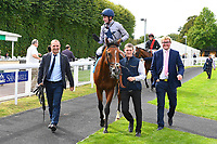 Winner of The Irish Yearling Sales Nursery Stakes Headland ridden by Oisin Murphy and trained by Martyn Meade is led into the winners enclosure during the Bathwick Tyres & EBF Race Day at Salisbury Racecourse on 6th September 2018