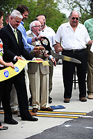 NWA Democrat-Gazette/FLIP PUTTHOFF <br />Dick Trammel of Rogers, chairman of the Arkansas Highway Commission, cuts a ribbon Wednesday May 10 2017 during dedication of a section of the Bella Vista bypass. U.S. Rep. Steve Womack (R-Rogers) (left) takes part in the dedication.