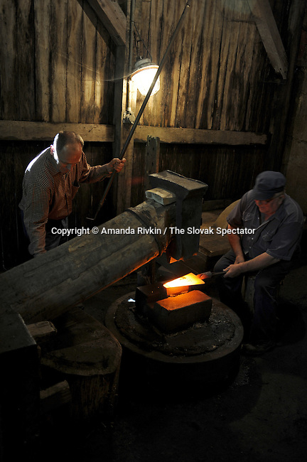 An iron craftsmen works according to 14th century Germanic methods in a hammer mill in Medzev, Slovakia on June 5, 2010.  Medzev has a significant German minority roughly equivalent to 12.5 percent of the town's population, but a town must have at least a quarter of its residents be of the same minority to qualify for dual signs at the entrance to the town; Medzev's German name is Metsenseifen.