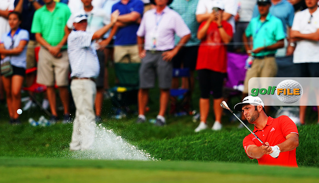 Jon Rahm (ESP) hits from a bunker on the 17th green  during 100th PGA Championship with his caddie Ricky Elliott at Bellerive Country Club, St. Louis, Missouri.<br /> Picture Tom Russo / Golffile.ie<br /> <br /> All photo usage must carry mandatory copyright credit (© Golffile   Tom Russo)
