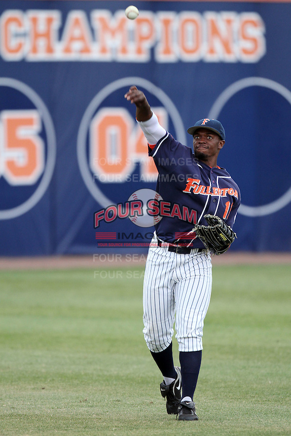Ivory Thomas #11 of the Cal. St. Fullerton Titans makes a throw against the Cal. St. Long Beach 49'ers at Goodwin Field in Fullerton,California on May 14, 2011. Photo by Larry Goren/Four Seam Images