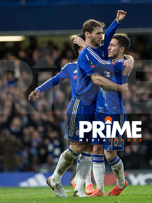 Branislav Ivanovic of Chelsea celebrates with goal scorer Eden Hazard of Chelsea during the FA Cup 5th round match between Chelsea and Manchester City at Stamford Bridge, London, England on 21 February 2016. Photo by Andy Rowland.