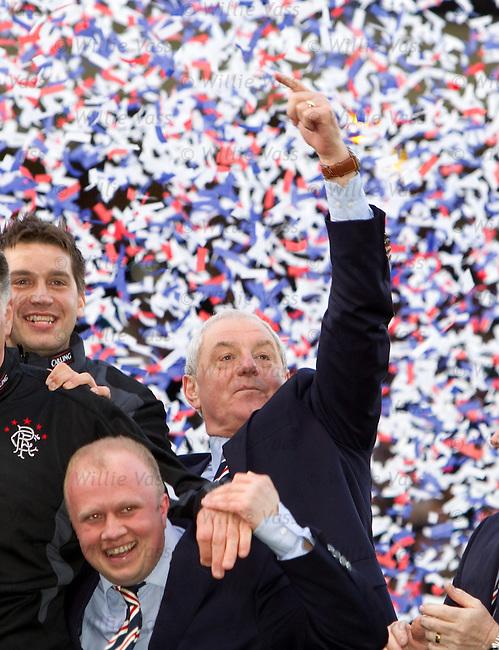 Walter Smith celebrates as the confetti flies