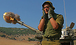 An Israeli soldier stands behind 155mm mobile artillery firing into southern Lebanon, from a position on the Israeli-Lebanese border August 6, 2006. Hizbollah killed 11 Israeli soldiers on Sunday in its deadliest rocket strike yet and Israeli bombs killed 18 Lebanese civilians as Lebanon rejected a draft U.N. resolution to end the 26-day-old war...JINI/ANCHO GOSH/EPA