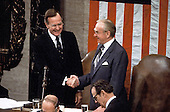 United States Vice President George H.W. Bush, left, is congratulated by the Speaker of the US House or Representatives Jim Wright (Democrat of Texas), right, after reading the result of the Electoral College vote electing him the 41st President of the United States during a Joint Session of the United States Congress on January 4, 1989.  Bush received 426 electoral votes and his Democratic opponent Michael Dukakis received 111.<br /> Credit: Ron Sachs / CNP