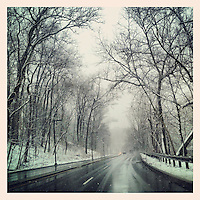 Snow falls on Lincoln Drive on March 8, 2013.