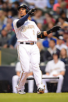 Milwaukee Brewers outfielder Carlos Gomez #27 hits a home run during a game against the Minnesota Twins at Miller Park on May 27, 2013 in Milwaukee, Wisconsin.  Minnesota defeated Milwaukee 6-3.  (Mike Janes/Four Seam Images)