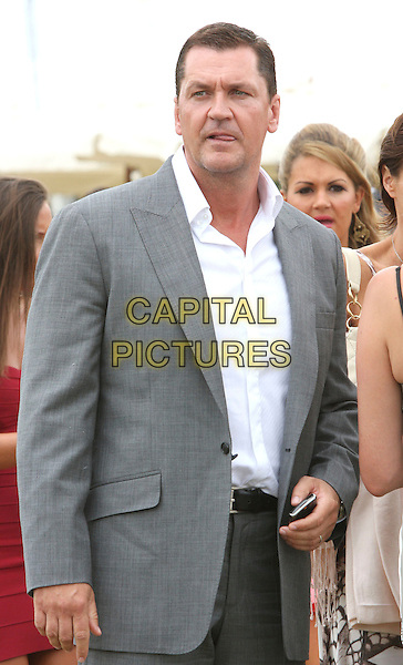 CRAIG FAIRBRASS .Duke Of Essex Polo Trophy at Gaynes Park, Epping, Essex, England, UK,.July 4th 2009..half length grey gray suit white shirt jacket phone .CAP/ROS.©Steve Ross/Capital Pictures