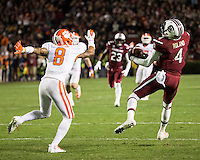 The tenth ranked South Carolina Gamecocks host the 6th ranked Clemson Tigers at Williams-Brice Stadium in Columbia, South Carolina.  USC won 31-17 for their fifth straight win over Clemson.  South Carolina Gamecocks wide receiver Shaq Roland (4) catches the ball in front of Clemson Tigers cornerback Darius Robinson (8)